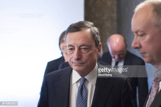 Mario Draghi president of the European Central Bank departs the ECB rate decision news conference at the Latvian central bank also known as Latvijas...