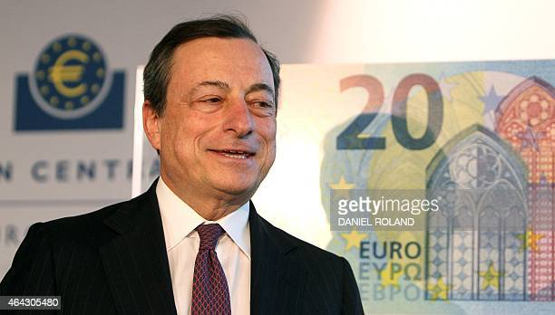Mario Draghi President of the European Central Bank ECB presents the new 20 EURO note in Frankfurt am Main central Germany on February 24 2015 AFP...