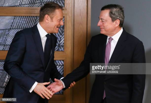 Mario Draghi President of the European Central Bank is welcomed by European Council President Donald Tusk prior to a meeting at the Europa building...