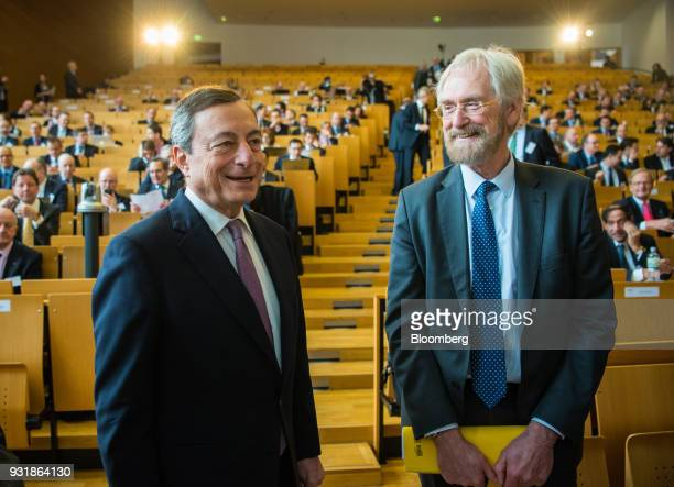 Mario Draghi president of the European Central Bank left and Peter Praet chief economist at the European Central Bank talk before taking the stage to...