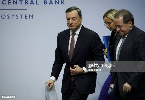 Mario Draghi president of the European Central Bank left Christine Graeff director general for communications at the European Central Bank center...