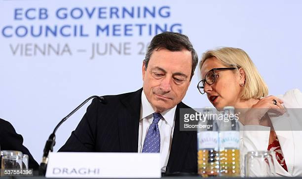 Mario Draghi president of the European Central Bank left listens as Christine Graeff director general for communications at the European Central Bank...