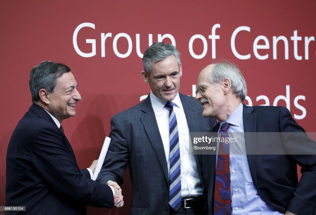 Mario Draghi, president of the European Central Bank (ECB), left, shakes hands with William Coen, secretary general of the Basel Committee, center, as Stefan Ingves, governor of the Sveriges Riksbank and chairman of the Basel Committee, reacts at the end of a Basel III capital rules news conference at the European Central Bank (ECB) headquarters in Frankfurt, Germany, on Thursday, Dec. 7, 2017. Big European mortgage lenders in low-risk markets may be the hardest hit by new capital rules that global regulators are expected to complete this week after a year-long deadlock. Photographer: Alex Kraus/Bloomberg via Getty Images