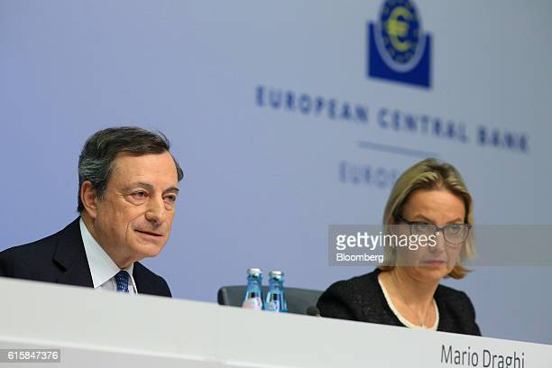 Mario Draghi president of the European Central Bank left speaks as he sits beside Christine Graeff director general for communications at the...