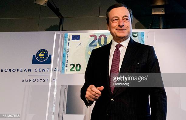 Mario Draghi president of the European Central Bank looks on as he unveils a new twenty euro banknote at the ECB headquarters in Frankfurt Germany on...