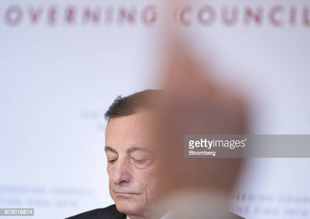 Mario Draghi president of the European Central Bank pauses as a journalist raises their hand during the European Central Bank rate decision at the...
