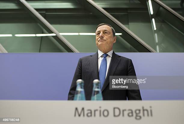 Mario Draghi president of the European Central Bank pauses before taking his seat for a news conference to announce the bank's interest rate decision...