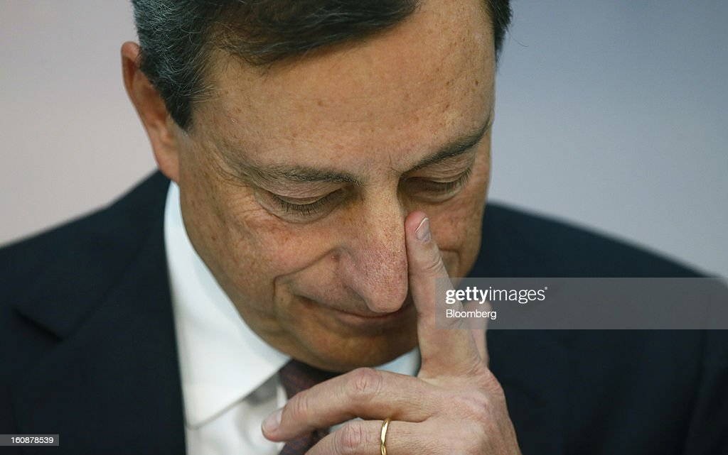 Mario Draghi, president of the European Central Bank (ECB), pauses during a news conference at the bank's headquarters in Frankfurt, Germany, on Thursday, Feb.7, 2013. The European Central Bank left interest rates unchanged even as a stronger currency threatens the euro area's recovery from recession. Photographer: Ralph Orlowski/Bloomberg via Getty Images