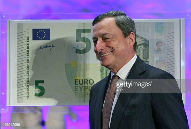 Mario Draghi President of the European Central Bank poses in front of a giant five euro note during the unveiling ceremony of the new 5 euros...