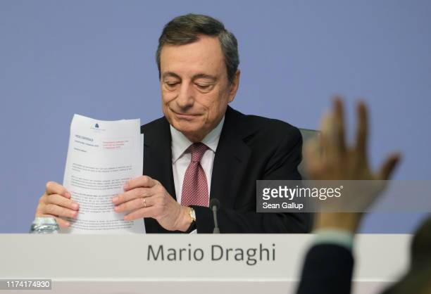 Mario Draghi President of the European Central Bank prepares to answer a reporter's question following a meeting of the ECB governing board on...