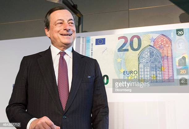 Mario Draghi president of the European Central Bank reacts as he unveils a new twenty euro banknote at the ECB headquarters in Frankfurt Germany on...