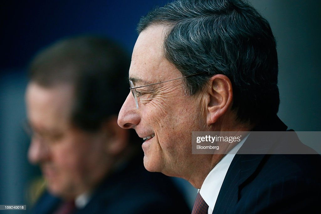 Mario Draghi, president of the European Central Bank (ECB), right, reacts during a news conference at the bank's headquarters in Frankfurt, Germany, on Thursday, Jan. 10, 2013. Draghi said the euro-area economy will slowly recover this year as the region's bond markets stabilize after three years of turmoil. Photographer: Ralph Orlowski/Bloomberg via Getty Images