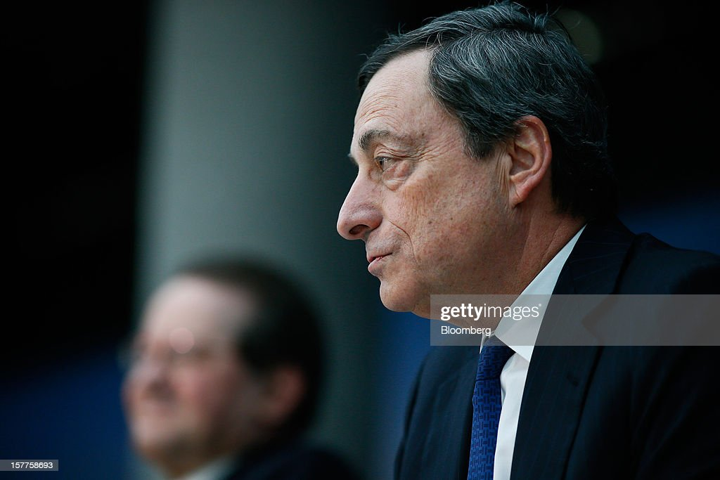 Mario Draghi, president of the European Central Bank (ECB), right, speaks during a news conference at the bank's headquarters in Frankfurt, Germany, on Thursday, Dec. 6, 2012. The European Central Bank cut its economic and inflation forecasts and Draghi said weakness will persist into next year, leaving the door ajar for further interest-rate cuts. Photographer: Ralph Orlowski/Bloomberg via Getty Images