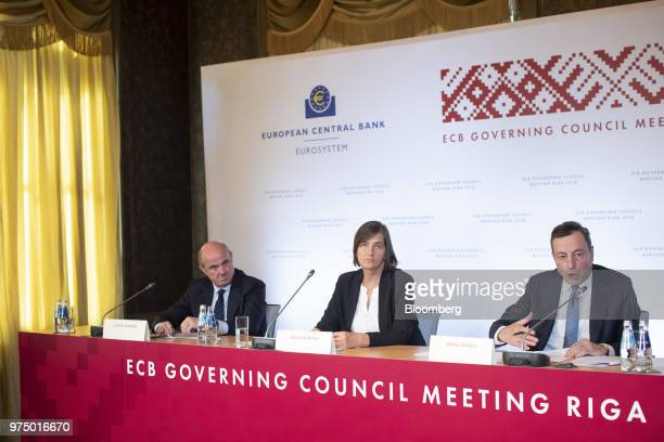 Mario Draghi president of the European Central Bank right speaks on a panel with Zoja Razmusa deputy governor of the Bank of Latvia center and Luis...