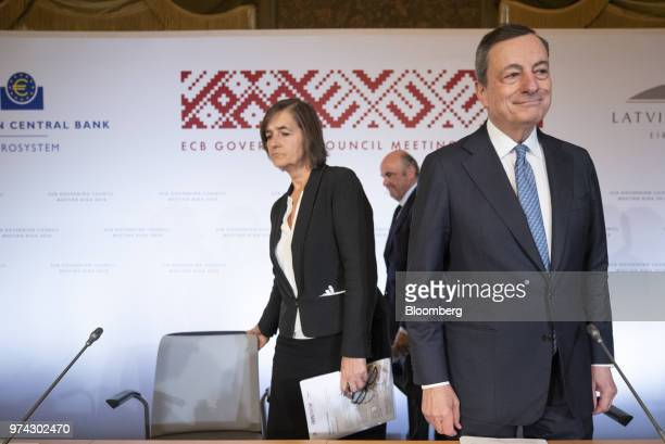 Mario Draghi president of the European Central Bank right Zoja Razmusa deputy governor of the Bank of Latvia right and Luis de Guindos vice president...