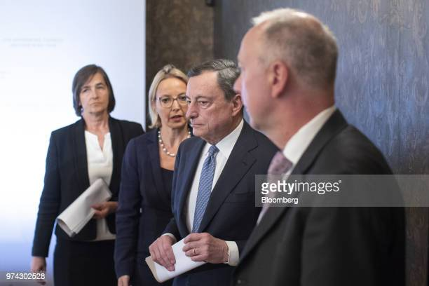 Mario Draghi president of the European Central Bank second left Zoja Razmusa deputy governor of the Bank of Latvia right and Christine Graeff...