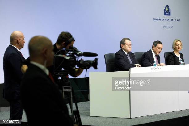 Mario Draghi president of the European Central Bank second right speaks as he sits between Christine Graeff director general for communications at...