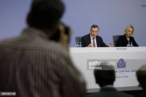 Mario Draghi president of the European Central Bank speaks as Christine Graeff director general for communications at the European Central Bank...