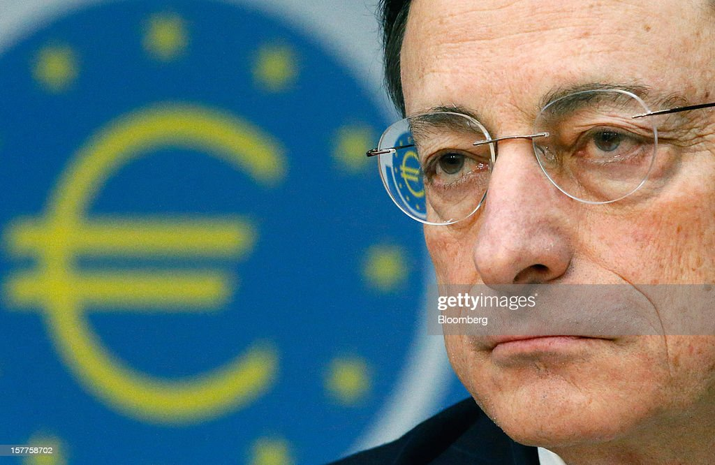 Mario Draghi, president of the European Central Bank (ECB), speaks during a news conference at the bank's headquarters in Frankfurt, Germany, on Thursday, Dec. 6, 2012. The European Central Bank cut its economic and inflation forecasts and Draghi said weakness will persist into next year, leaving the door ajar for further interest-rate cuts. Photographer: Ralph Orlowski/Bloomberg via Getty Images