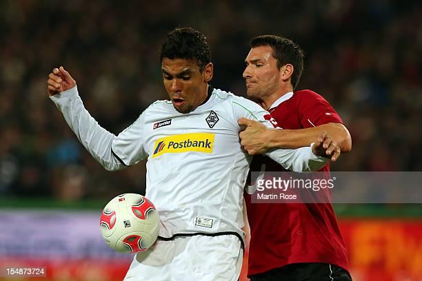 Mario Eggimann of Hannover and Igor de Camargo of Gladbach battle for the ball during the Bundesliga match between Hannover 96 and Borussia...