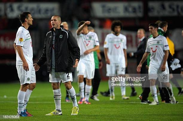 Mario Eggimann of Hannover and teammate Leon Andreasen discuss after the UEFA Europa League Group L match between Twente Enschede and Hannover 96 at...