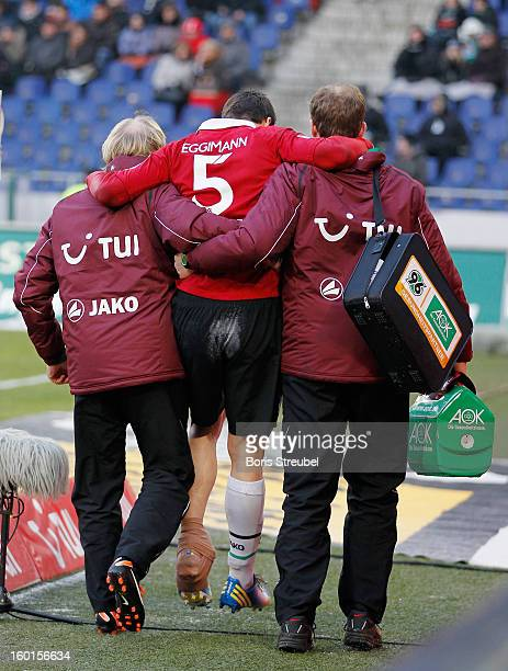 Mario Eggimann of Hannover leaves the pitch with team doctors after getting injured during the Bundesliga match between Hannover 96 and VfL Wolfsburg...