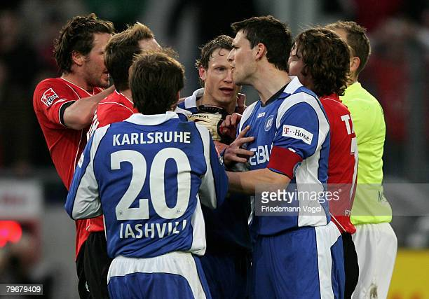 Mario Eggimann of Karlsruhe fights with Hanno Balitsch of Hannover during the Bundesliga match between Hannover 96 and Bayer Leverkusen at the AWD...