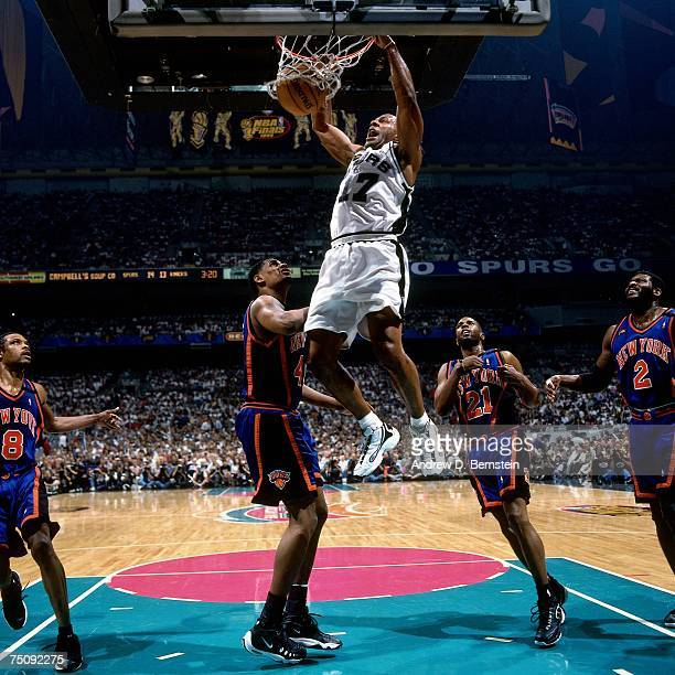 Mario Elie of the San Antonio Spurs dunks against Kurt Thomas of the New York Knicks in Game Two of the 1999 NBA Finals played at the Alamodome on...