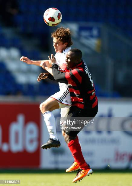 Mario Erb of Bayern Muenchen and Addy Waku Menga head for the ball during the Third League match between SV Wehen Wiesbaden and Bayern Muenchen II at...