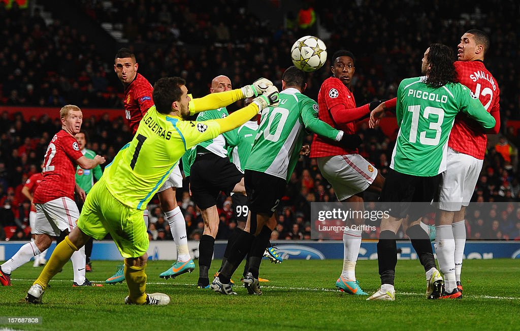 Mario Felgueiras of CFR 1907 Cluj punches clear under pressure during the UEFA Champions League Group H match between Manchester United and CFR 1907 Cluj at Old Trafford on December 5, 2012 in Manchester, England.