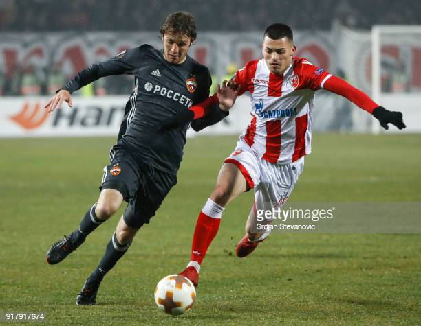 Mario Fernandes of CSKA Moscow in action against Nemanja Radonjic of Crvena Zvezda during the UEFA Europa League Round of 32 match between Crvena...