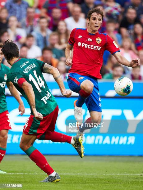 Mario Fernandes of PFC CSKA Moscow and Vedran Corluka of FC Lokomotiv Moscow vie for the ball during the Russian Football League match between PFC...