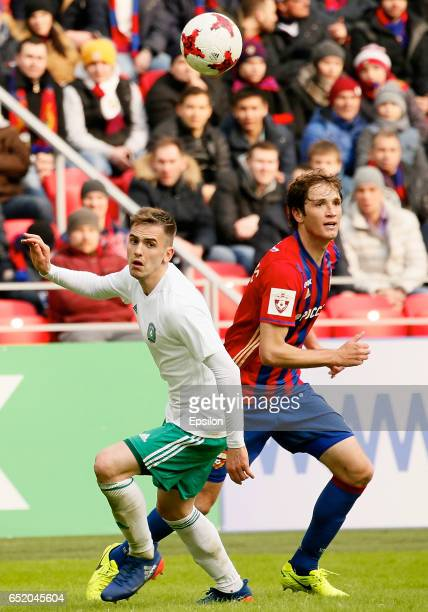 Mario Fernandes of PFC CSKA Moscow challenged by Artem Popov of FC Tom Tomsk during the Russian Premier League match between PFC CSKA Moscow and FC...