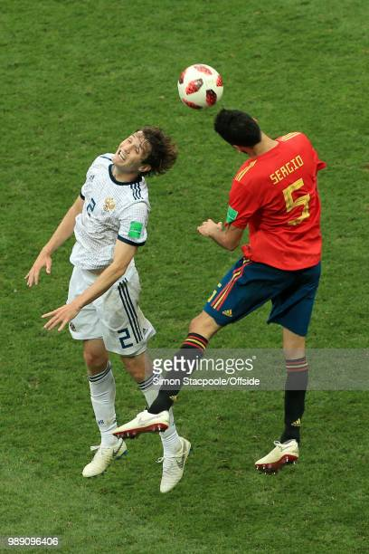 Mario Fernandes of Russia battles with Sergio Busquets of Spain during the 2018 FIFA World Cup Russia Round of 16 match between Spain and Russia at...