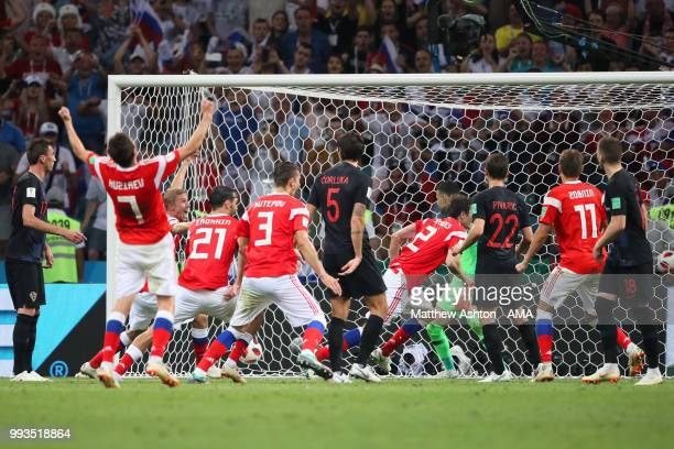 Mario Fernandes of Russia celebrates scoring a goal to make it 22 in extra time during the 2018 FIFA World Cup Russia Quarter Final match between...