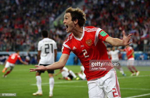 Mario Fernandes of Russia celebrates the 2nd Russia goal scored by Denis Cheryshev of Russia during the 2018 FIFA World Cup Russia group A match...
