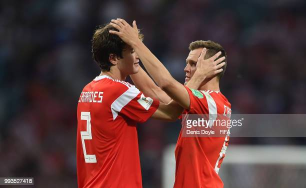 Mario Fernandes of Russia is consoled by Denis Cheryshev after losing to Croatia in extra time penalty shootout during the 2018 FIFA World Cup Russia...