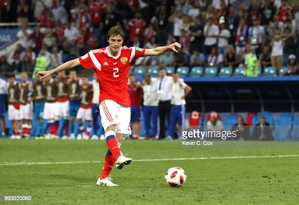 Mario Fernandes of Russia misses his team's third penalty in the penalty shoot out during the 2018 FIFA World Cup Russia Quarter Final match between...