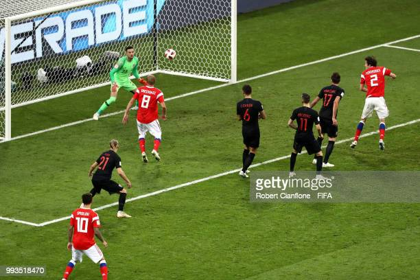 Mario Fernandes of Russia scores past Danijel Subasic of Croatia his team's second goal during the 2018 FIFA World Cup Russia Quarter Final match...