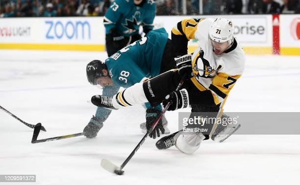Mario Ferraro of the San Jose Sharks collides with Evgeni Malkin of the Pittsburgh Penguins at SAP Center on February 29, 2020 in San Jose,...