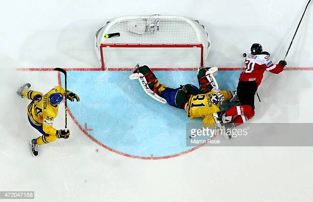Mario Fischer of Austria fails to score over Anders Nilsson , goaltender of Sweden during the IIHF World Championship group A match between Austria...