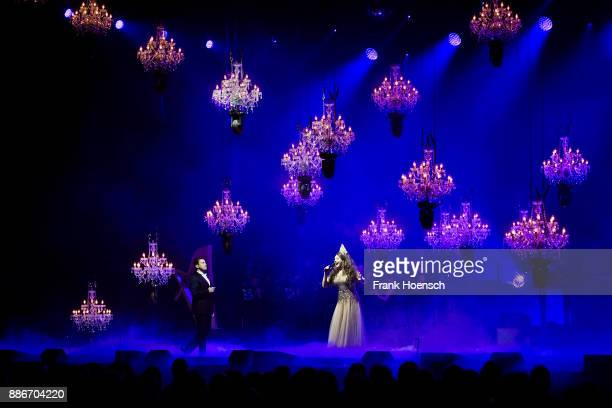 Mario Frangoulis and Sarah Brightman perform live on stage during the Royal Christmas Gala at the Tempodrom on December 5 2017 in Berlin Germany