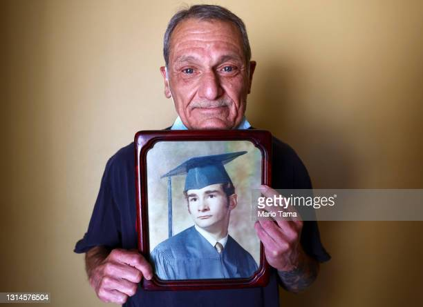 Mario Frausto holds a high school graduation photo of his deceased husband Terrance Sheppard, who passed away on March 25 due to complications from...