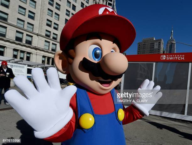 Mario from Super Mario Bros poses for pictures as the Nintendo Switch is unveiled at a popup Living room in Madison Square Park in New York on March...