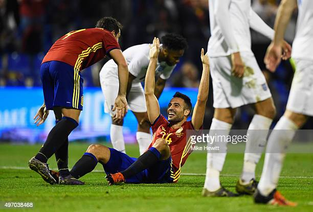 Mario Gaspar of Spain celebrates with Paco Alcacer Garcia as he scores their first goal during the international friendly match between Spain and...