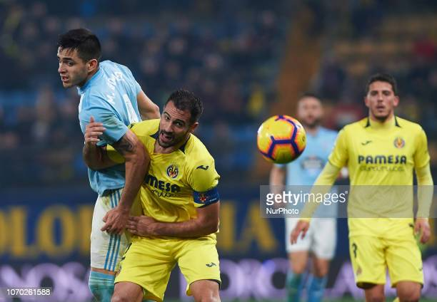 Mario Gaspar of Villarreal CF and Maxi Gomez of Real Club Celta de Vigo during the La Liga match between Villarreal CF and Real Club Celta de Vigo at...