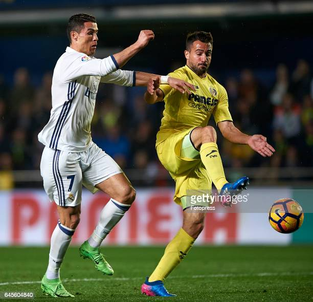 Mario Gaspar of Villarreal competes for the ball with Cristiano Ronaldo of Real Madrid during the La Liga match between Villarreal CF and Real Madrid...