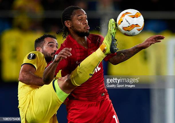 Mario Gaspar of Villarreal competes for the ball with Luiz Adriano of Spartak Moscow during the UEFA Europa League Group G match between Villarreal...