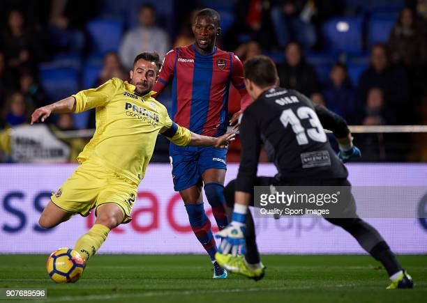 Mario Gaspar of Villarreal competes for the ball with Oier Olazabal of Levante during the La Liga match between Villarreal and Levante at Estadio de...