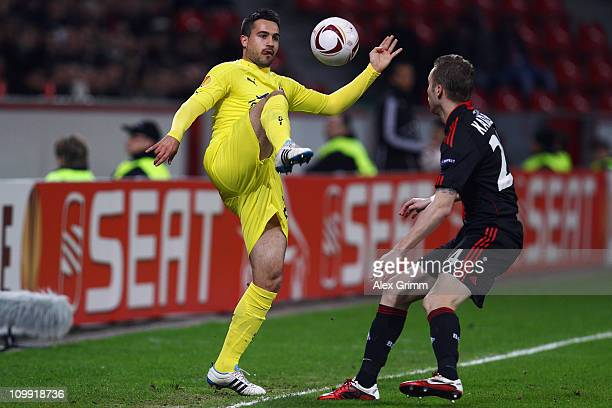 Mario Gaspar of Villarreal is challenged by Michal Kadlec of Leverkusen during the UEFA Europa League round of 16 first leg match between Bayer...